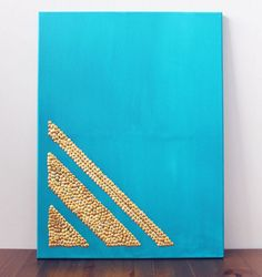 Thumbtack wall art—who knew office supplies could be so chic?