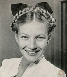 Summer-perfect milkmaid braids, as modeled by Veronica Lake in Life feature, November 24, 1941.