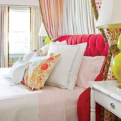This bed is crisp and beautiful with sweet boudoir pillows and euro shams as accents.   SouthernLiving.com