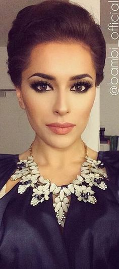 Elegant/ classy makeup. This you could really rock TESS! These colors would make your dark eyes really striking!