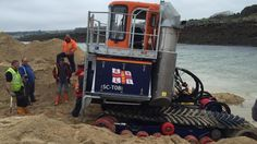 RNLI Shannon recovery vehicle stuck on Hayle beach near St Ives after tracks came off during training exercise in September 2015