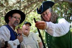 Gregg Hardy shows off an antique muzzle loader to Dick Ashford and Jimmy Jones at America's Freedom Festival's Colonial Heritage Festival at SCERA Park in Orem on Thursday, July 2, 2015. GRANT HINDSLEY, Daily Herald