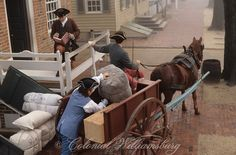 Loading goods into the Prentis Store from a horse drawn cart. Historic Colonial Williamsburg, Virginia. Photo by David M. Doody