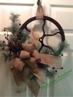 Repurposed Sewing machine pulley wreath.