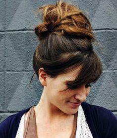 Messy Top Knot with Sweeping Bangs Updos