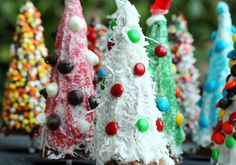 instead of gingerbread houses, turn ice cream cones into christmas trees & decorate