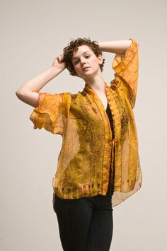 Saffron Organza Kimono by Dianne Koppisch: Hand painted with fiber reactive dye, 100% organza silk, serged edge.