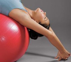 Model using exercise ball | Tone up and slim down with these six easy moves.