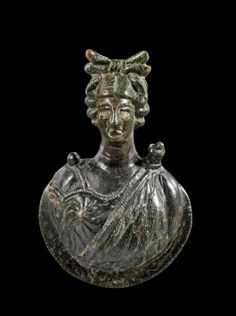 Roman bronze applique. Bust of Artemis with quiver and animal skin. 1st - 3rd century A.D.