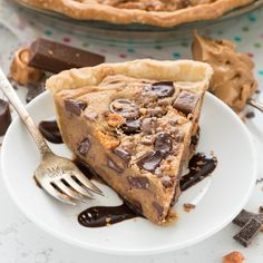 Peanut Butter Candy Bar Pie - a giant peanut butter cookie in a pie crust filled with tons of candy! The perfect dessert recipe!
