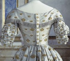 Dress (back detail of bodice), worn by Queen Josefina, née Joséphine de Beauharnais (Leuchtenberg), for her coronation as queen of Sweden on September 28, 1844, in Stockholm. Silver fabric with sewn crowns of different sizes embroidered with gold sequins. Court sleeves in silver silk satin, collar trimmed with silver fringe. Collection of the Royal Armory, Stockholm. CLICK FOR VERY LARGE, HI-RES IMAGE.