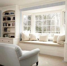bay window seat with white pillows