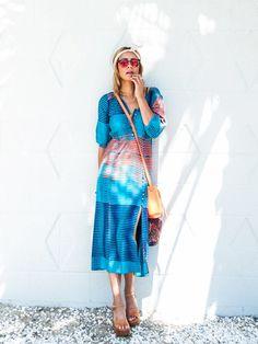 Taye Hansberry of Stuff She Likes in a striped midi dress and mini crossbody bag