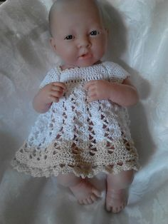 This dress is crocheted from size 10 cotton thread to fit a preemie baby or 14 inch Berenguer La Newborn. Gauge is not really important but I got about 7 sc in one inch.
