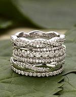 This regal Edwardian-inspired band showcases three single cut diamonds set in 18K white gold. Gorgeous pierced details in the gallery lead to a knife-edge shank with delicate engravings (approx. 0.04 total carat weight).