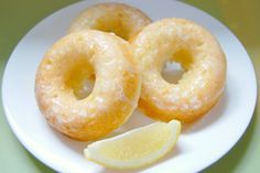 "Baked Lemon Donuts.  These donuts are light and fluffy and ""dressed"" with a lemon glaze. Also, because these donuts are baked, and are also packed with lemon zest and Greek yogurt, they are a nice alternative to the dense, chocolate-focused, store-bought donuts I am accustomed to!"