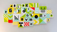 Wooden alphabet wall art created by designer Jason Gomez for his daughter's nursery. Love!