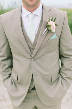 36 Groom Suit That Express Your Unique Styles and Personalities For so long the grooms have been too traditional with their wedding attire, while in 2017 you might see some difference in the groom attire or groom suits. Beach Wedding Groom Attire, Groom And Groomsmen Attire, Groom Suits, Beach Attire, Mens Wedding Attire Summer, Beige Suits Wedding, Beach Groom, Wedding Ideas For Groom, Beach Wedding Attire For Men