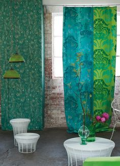Fabulous Kashgar fabric from AW13 made up of bright green and jade with darker overlaid details giving an overall glistening green appearance.