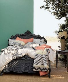 Myriad patterns in white and pewter to accent bed frame -- then softening colors