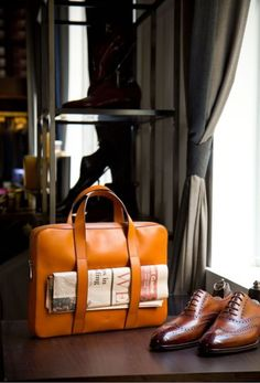 This is great update on the traditional briefcase. The vibrant tan colour and sleek look softens the statement of corporate blandness and denotations of high status.