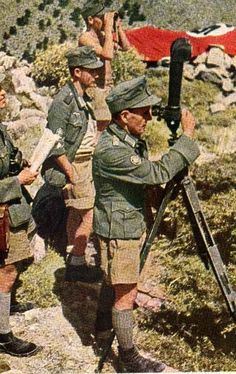 """German Gebirgsjägers (""""Mountain Hunters"""") scout out their surroundings before engaging their next operation atop the foothills of Greece during the 1941 offensive in the Mediterranean nation that was supported by the British Empire."""