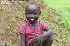 February 17:  A young girl flashes a brilliant smile from South Sudan.   Photo: Margaret Aguirre, International Medical Corps, South Sudan 2012