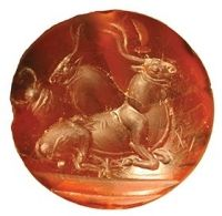 Minoan style bull intaglio from a 15th century B.C. grave with more than 1,400 objects.  Southern Greece.