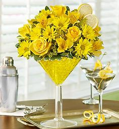 Sure Cure™- bright arrangement of roses, daisy poms, alstroemeria, solidago and variegated pittosporum in reusable, oversized acrylic martini glass $39.99- $69.99