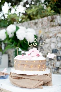 Image by Helen Cawte Photography - Rustic Barn Wedding With Bride In Gold Sequinned Project D Gown With A Jenny Packham Headpiece And Bridesmaids In White Maxi Dresses From M&S With Groom In Hugo Boss Suit And A Great Wedding Bake Off Dessert Table