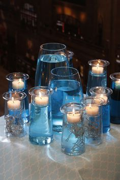 Can fill with any color water or items to match the theme of the wedding then add Partylite candles for the perfect touch (Symmetry Trio).
