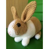 """You could use any yarn weight for these bunnies as long as you choose a fitting hook, it will only influence the finished size. My example rabbits were made with DK yarn and 3mm hook, they are about 8"""" long and 6"""" tall to the tip of the ears. The pattern is 9 pages long with many photographs illustrating the process. It is written in English with US crochet terms. Stitches and techniques used: starting with magic ring, chain, slip stitch, single crochet, single crochet increase, invisible…"""