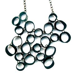 """""""Orbital Necklace...circular shapes from a recycled bike inner tube, ...linked together with metal jump rings."""""""