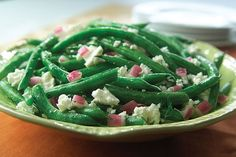 Fresh green beans are cooked until crisp-tender and tossed with crumbled feta and chopped red onions to make this tasty—and good-looking—side dish.