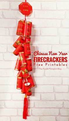 Make this awesome string of paper Chinese firecrackers to celebrate the Chinese New Year! Free printable + instructions included.