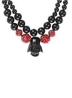 "<p>Beaded black layered statement necklace from <i>Star Wars</i> with red rose bead accents and a metal Darth Vader helmet pendant design.</p>  <ul> <li>18"" long; 3"" extender; 1"" pendant</li> <li>Man-made materials; alloy</li> <li>Imported</li> </ul>"