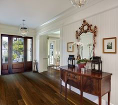 Simply gracious foyer by Structures Building Company.
