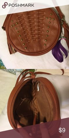 Boho crossbody handbag Boho inspired crossbody purse with feather and studs embellishments. Like new condition. Clean, scuff free, and from a smoke free home. Offers welcome. Bags Crossbody Bags