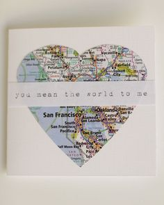 "This lovely valentine features a hand cut heart and bears the sentiment ""you mean the world to me.""                                                                                                                                                                                 More"
