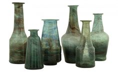 Bottle vases- •handmade from recycled glass. Beautiful color!