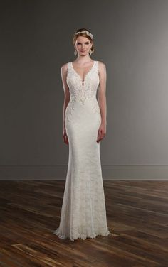 This sleek Martina Liana wedding gown boasts elegant pearl-beaded Guipure lace details, a low V neckline, and a sexy illusion back that zips up under pearl buttons. The skirt features scalloped lace details and a modest court train.