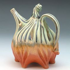 Hand carved porcelain teapot in green & orange by robertapolfus