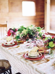 Sophisticated Burgundy & Plum Southern Wedding Inspiration | Tablescape with Gold Chevron Sequin Linens + Vintage Chairs + Stacked Books + Gold Flatware