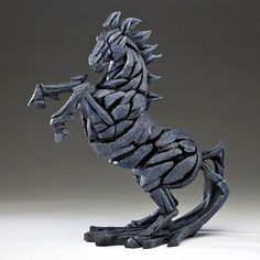 Image from http://www.sinclairsjewellers.co.uk/images/sculpture-ed07-horse-figure-matt-buckley-p2617-21974_zoom.jpg.