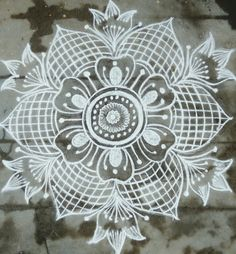 35 Best Mandala Rangoli designs to try - Wedandbeyond Indian Rangoli Designs, Rangoli Designs Latest, Simple Rangoli Designs Images, Rangoli Designs Flower, Rangoli Border Designs, Rangoli Patterns, Rangoli Designs With Dots, Beautiful Rangoli Designs, Flower Rangoli