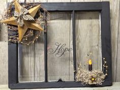 Primitive Panes. Primitive decorating. Decorated primitive with barn star and wreath. Grungy candle. Like us on Facebook - Primitive Panes for all our products.