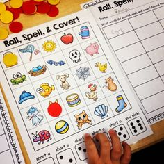Roll, Spell, and Cover! Students practice their phonemic awareness with this fun partner game.