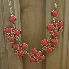 Francesca's coral statement necklace Great condition and a pretty color. I couldn't think of anything to pair it with so my loss might be your gain. Francesca's Collections Jewelry Necklaces
