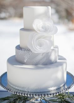 Looking for a winter wedding cake that's seasonal and stylish? We've rounded up the prettiest confections around, adorned with everything from mesmerizing sugar icicles to wintry evergreen branches.