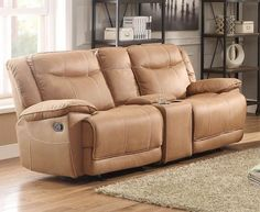 Wasola Collection Doble Glider Reclining Love Seat with Center Console 8414-2Designed for the ultimate in relaxation for those who take a seat, the Wasola Collection provides plush seating and unique features to serve your comfort needs. The center seat of the sofa reclines along with the two end seats, a function that equalizes the race for a relaxed position. Dual reclining seats of the love seat flank the functional center console's lift top storage and cup holders. A glider reclining…